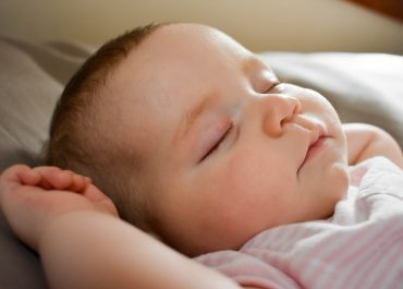 Touching your baby while sleeping